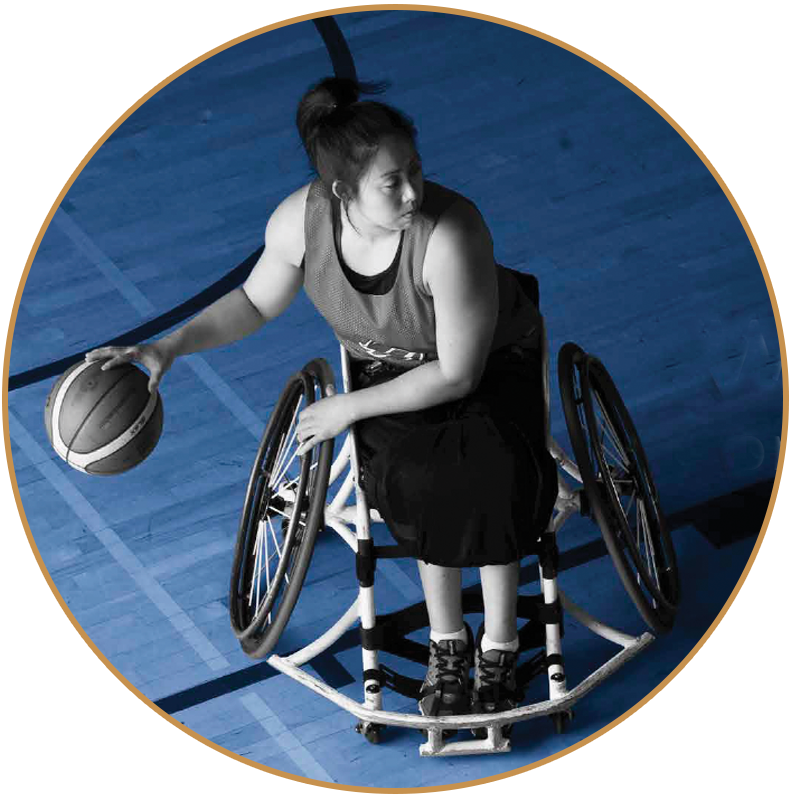 girl in wheelchair playing baseketball